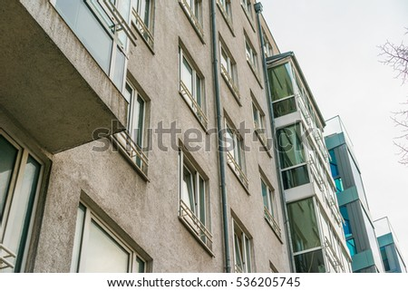 typical berlin apartment houses with stone and glass facade