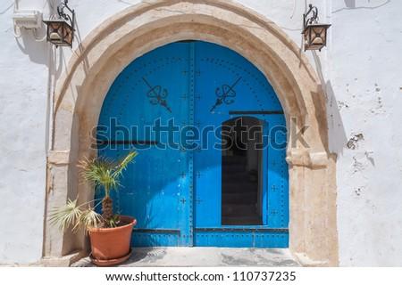 Typical blue door in Djerba/Tunisia - stock photo