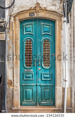 Typical blue doorway in the old town of Olhao, Algarve, Portugal, Europe - stock photo
