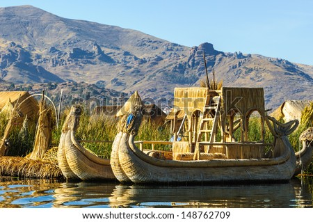 Typical boats of the Uros group of islands in Peru, Titicaca lake - stock photo