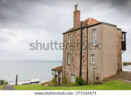 Typical British apartment building on the rough shores of Crail, Fife, close to St. Andrews, Scotland - stock photo
