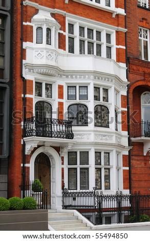 Typical british red brick mansion - stock photo