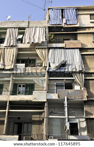 Typical building with curtains on balconies in Bourj Hammoud, Armenian district, Beirut, Lebanon, Middle East - stock photo