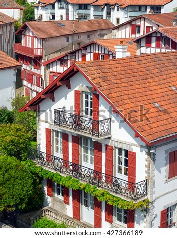 Typical buildings of Basque country in a street of Ciboure. Aquitaine, France. - stock photo