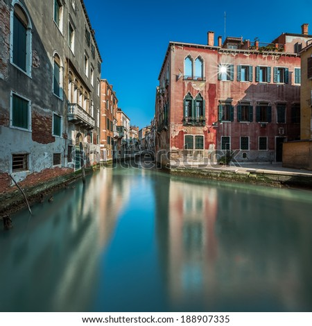 Typical Canal, Bridge and Historical Buildings in Venice, Italy - stock photo