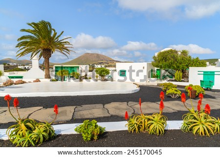 Typical Canarian style buildings and tropical plants, El Campesino Monumento, Lanzarote island, Spain - stock photo