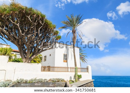 Typical Canarian white house on cliff edge with ocean in background and beautiful sky, Puerto de la Cruz, Tenerife, Canary Islands, Spain - stock photo
