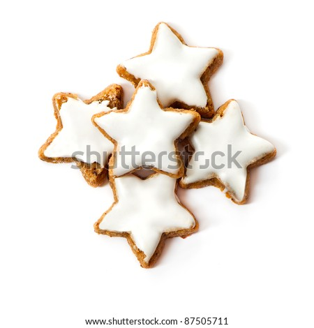 typical christmas cinnamon star cookies isolated on white - stock photo