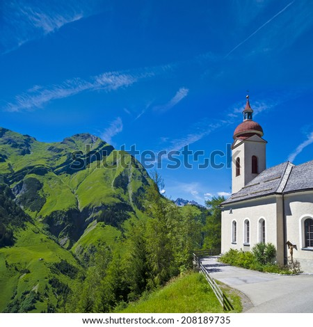 "typical church in ""Kaisers"" in the beautiful mountain summer landscape - stock photo"
