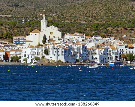 Typical coastal Mediterranean village of Cadaques, viewed from the sea, Catalonia, Costa Brava, Spain - stock photo