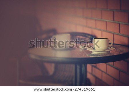 Typical  coffee terrace with tables and chairs  - stock photo
