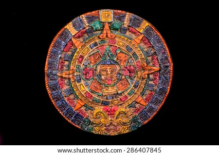 Typical Colored Clay Maya Calendar Isolated on Blackbackground - stock photo