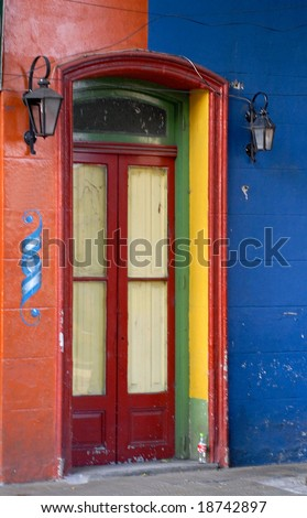 Typical colorful house with wooden door in the famous La Boca district in Buenos Aires, Argentina.
