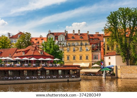 Typical colorful houses along Vltava river in Prague, Czech Republic. - stock photo