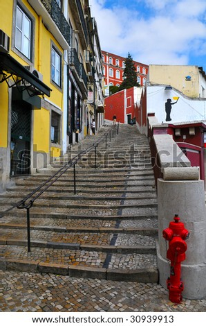 Typical colorful lisbon street with fire hydrant. - stock photo