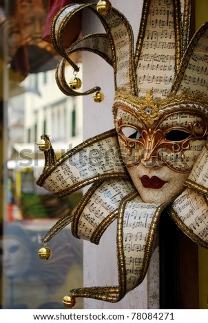 Typical colorful souvenir carnival mask in Venice, Italy - stock photo