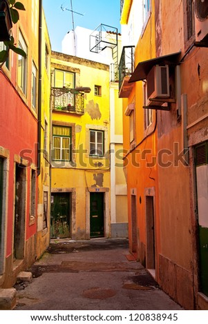 Typical colorful street from Lisbon in Portugal. - stock photo