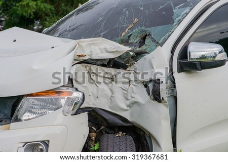 Typical compact car Corruption Car crash accident wreck - insurance concept broken glass of a car accident several cars collided in a traffic accident . High speed