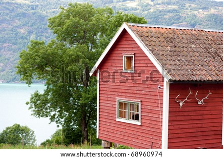 Typical country house by lake - hytte, Norway, Europe - stock photo