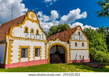 Typical Czech traditional farm house in Southern Bohemia with deep blue sky and trees-Czech Republic,Europe - stock photo