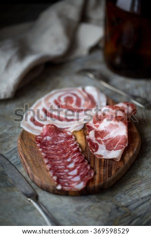 typical dish of Italian appetizer with salami, ham - stock photo