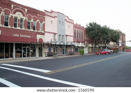 Typical downtown main street complete with furniture store and movie theater that could be almost any town in the Mid West United States. - stock photo