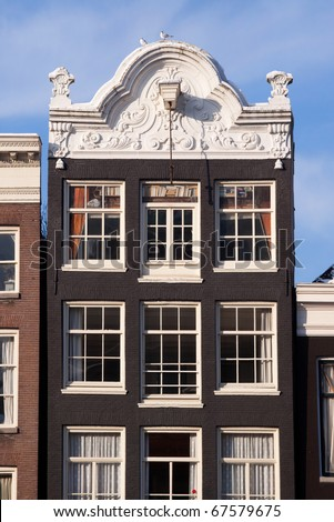 Typical Dutch house in Amsterdam, the Netherlands alongside one of its famous canals.