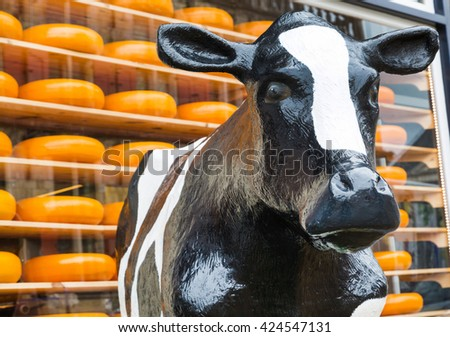 Typical dutch image of cow and cheese for sale in the shop - stock photo