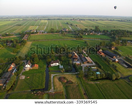 Typical dutch landscape viewed from an hot air balloon - stock photo