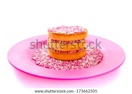 Typical Dutch mouse rusk on a plate for baby shower background pattern - stock photo