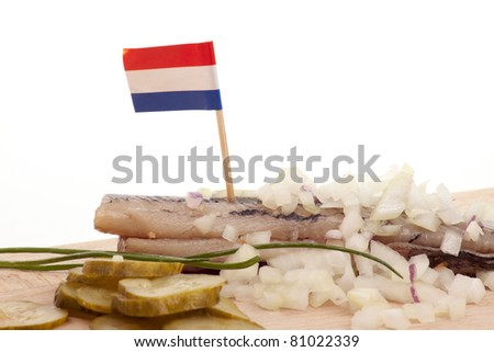 Typical Dutch salted herring called maatje or zoute haring - stock photo