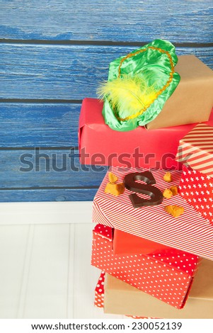 Typical Dutch Sinterklaas holidays with gifts, letter and pepernoten - stock photo
