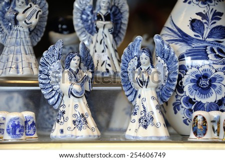 Typical Dutch souvenir of two angels in Delft Blue at a souvenir shop in Delft,Netherlands - stock photo