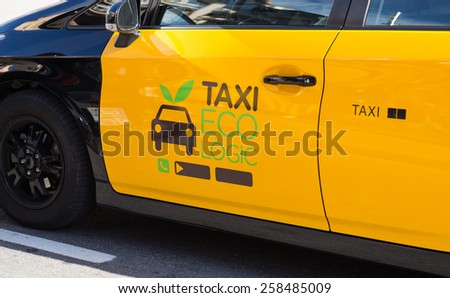 Typical ecological taxi in the city of Barcelona, Spain