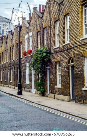 Typical English Architecture Residential Buildings In A Row Along The Street London