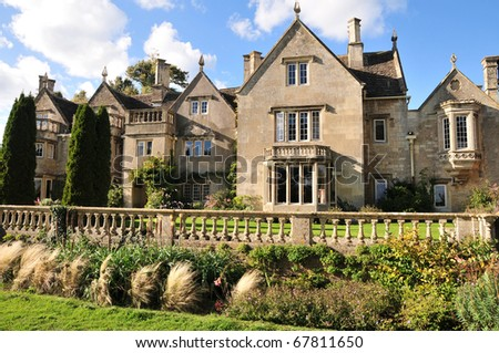 Typical English Victorian Era Mansion and Grounds - stock photo