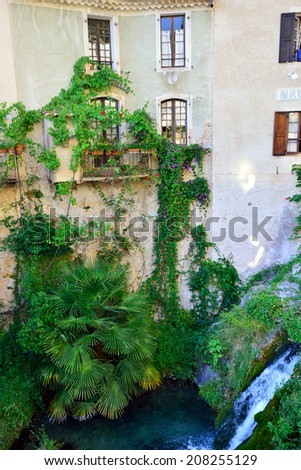 Typical facade in the street of the beautiful medieval village Moustiers Sainte Marie, Provence, France - stock photo