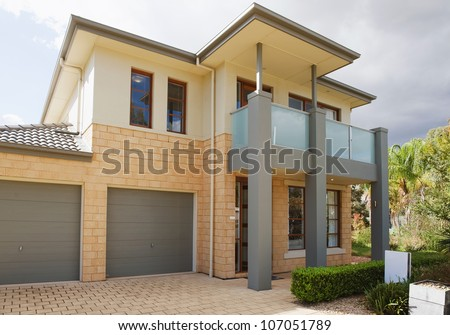 typical   facade of a modern australian house at noon - stock photo