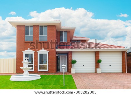 typical  facade of a modern suburban  house - stock photo