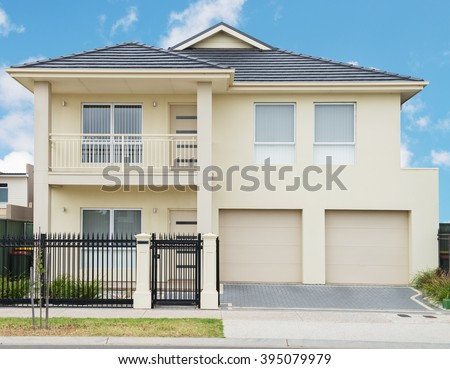 typical   facade of a modern suburban house at noon