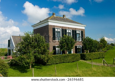 Typical family house in Netherlands and sunny day