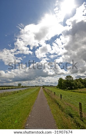 typical farmland landscape of the Netherlands - stock photo