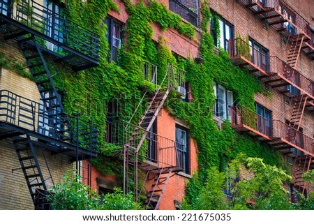 Typical fire escapes in Soho, NYC. - stock photo