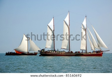 Typical fish boats in the sea, Netherlands A race of typical fish boats in Volendam - stock photo