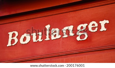 "Typical French bakery shop sign (""boulanger"" on French means ""baker""). Paris, France. - stock photo"