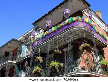Typical French Quarter wrought iron balconies in preparation for Mardi Gras - stock photo