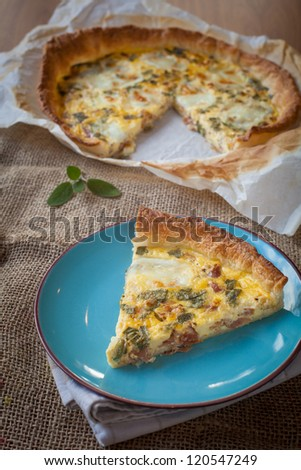 Typical french quiche cake with ham and sage - stock photo