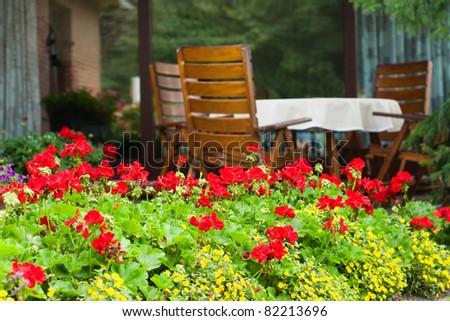 Typical German Garden with wooden garden furniture - stock photo