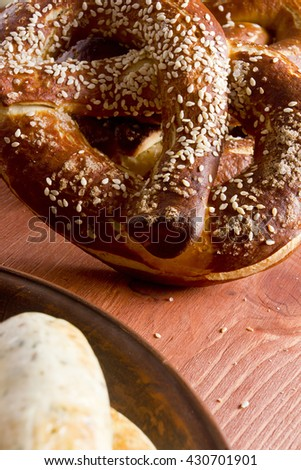 Typical German pretzel for a beer on a wooden table - stock photo