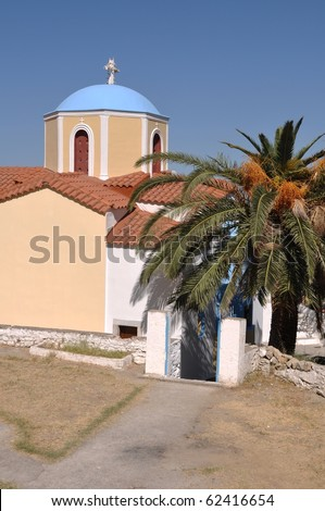 typical greek church in Zia village (Kos island), Greece (gorgeous blue sky) - stock photo